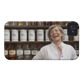 Laughing pharmacist standing in front of a shelf iPhone 4 Case-Mate case