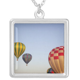 Launching hot air balloons 3 square pendant necklace