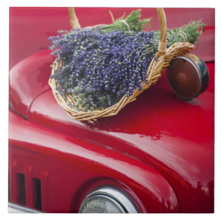 Lavender bunches rest on old farm pickup truck tile