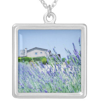 Lavender field with a building in the silver plated necklace