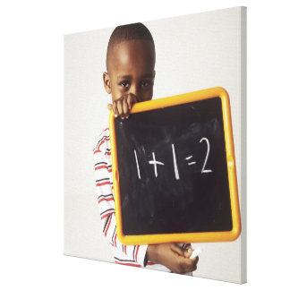 Learning arithmetic. 4-year-old boy holding a canvas print