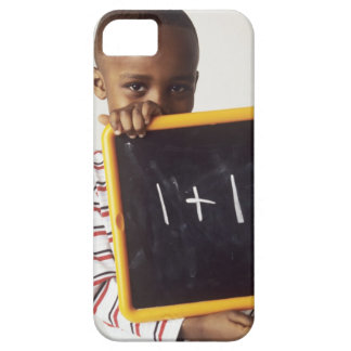 Learning arithmetic. 4-year-old boy holding a iPhone 5 cover