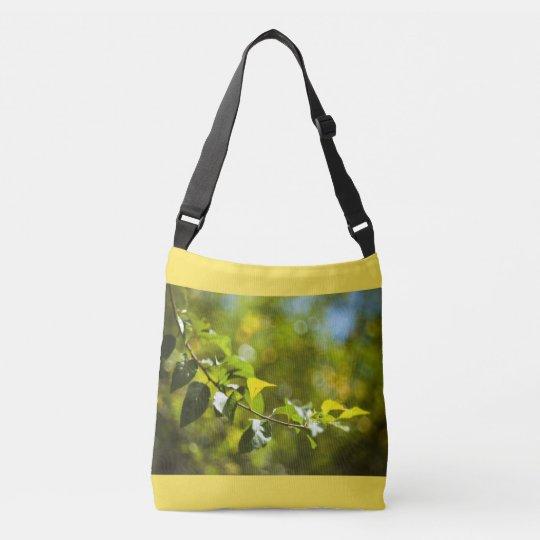 Leaves and bokeh crossbody bag