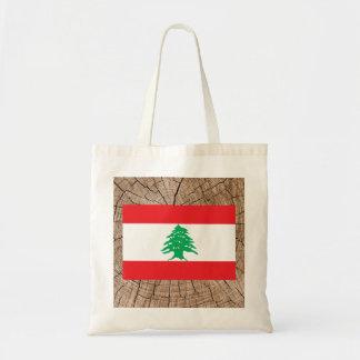 Lebanese flag on tree bark budget tote bag