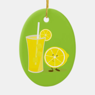 Lemon character standing next to lemonade christmas ornament