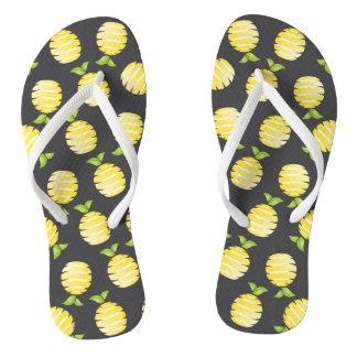 Lemon on black flip flops