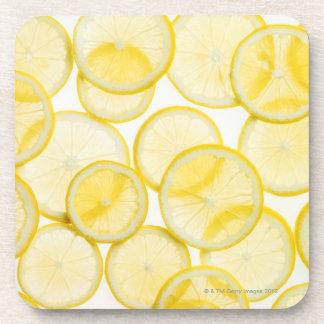 Lemon slices arranged in pattern backlit beverage coaster
