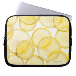 Lemon slices arranged in pattern backlit laptop sleeve