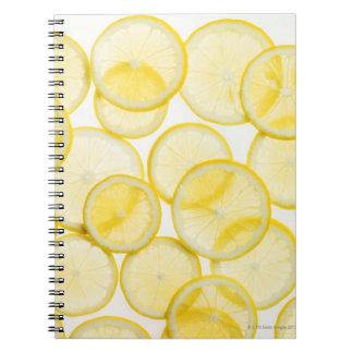 Lemon slices arranged in pattern backlit notebook