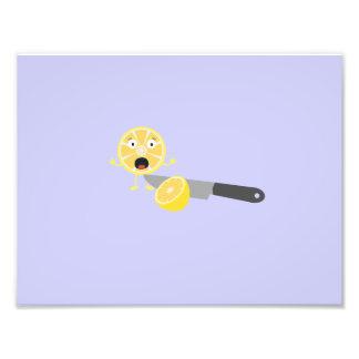 Lemon with knife photograph