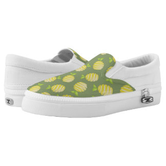 Lemons on green slip on shoes