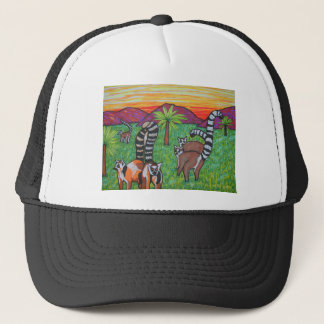 Lemurs in the grass trucker hat
