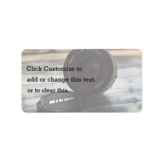 Lens of camera and cap address label