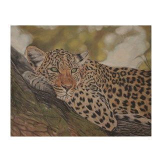 Leopard cat lying in a tree wood print