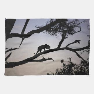 Leopard silhouette in a tree, Kenya Tea Towel