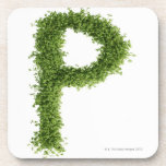 Letter 'P' in cress on white background, Coasters