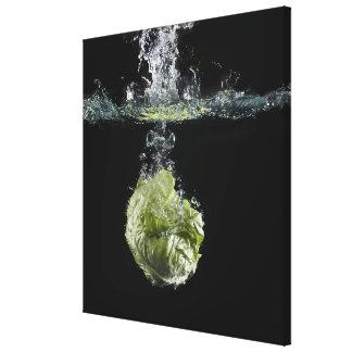 Lettuce splashing in water canvas print