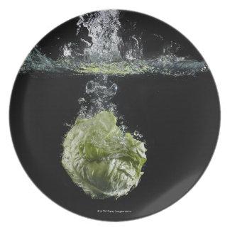 Lettuce splashing in water plate