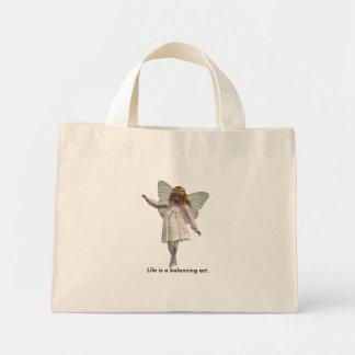 Life is a balancing act. mini tote bag