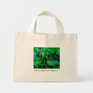 Life is waiting to happen with lilies in the pond canvas bag