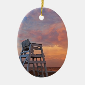 Lifeguard chair with dramatic sky. christmas ornament