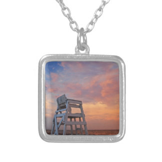 Lifeguard chair with dramatic sky. silver plated necklace