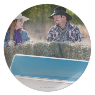 Lifting bales of hay party plates