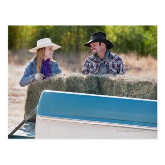 Lifting bales of hay postcard