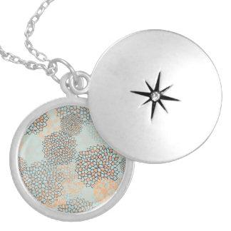 Light Blue and Tan Flower Burst Design Round Locket Necklace