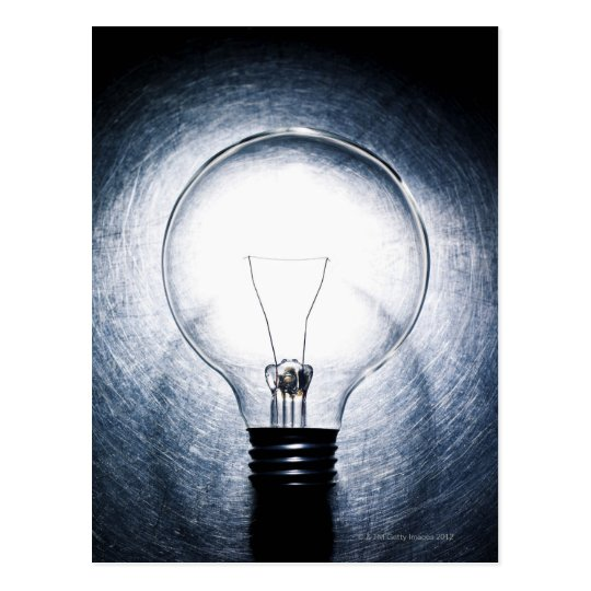 Light Bulb on Stainless Steel Background Postcard