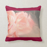 Light pink rose reflection in silver pillows