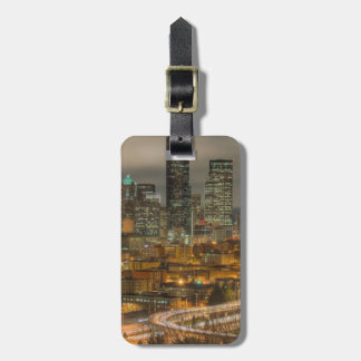 Light streaks from cars at night luggage tag