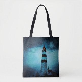 Lighthouse a dark blue rainy night tote bag
