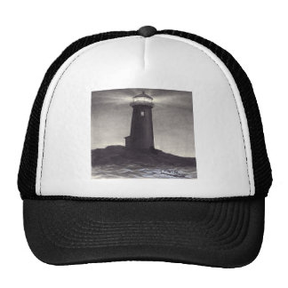 Lighthouse at night shining a light for a boat hats