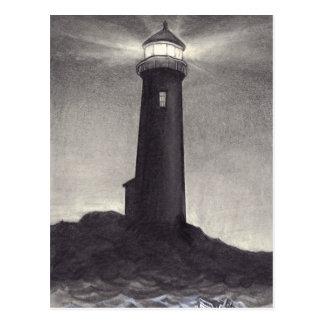 Lighthouse at night shining a navigation light postcard