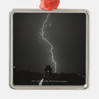 Lightning over city christmas ornament