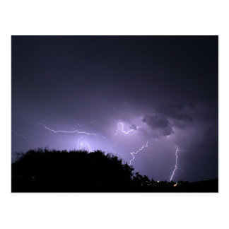 Lightning storm on purple sky postcard