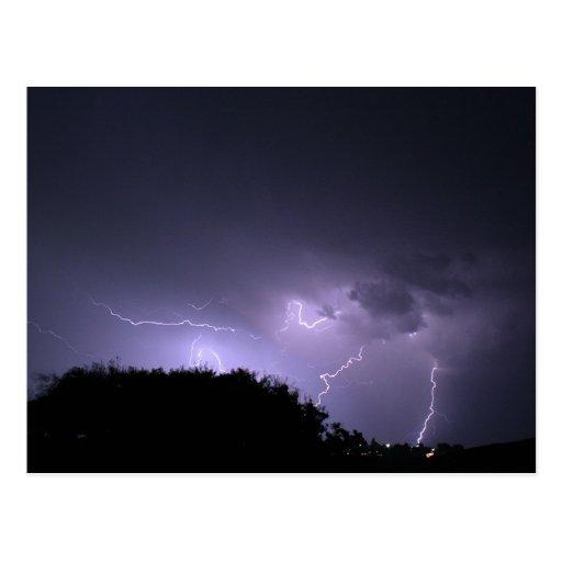 Lightning storm on purple sky postcards