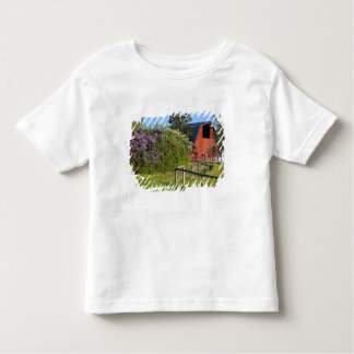 Lilac bushes in bloom and magpies in the trees toddler T-Shirt