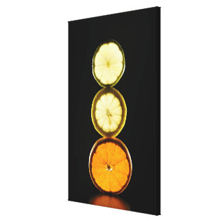 Lime,Grapefruit,Lemon,Fruit,Black background Canvas Print