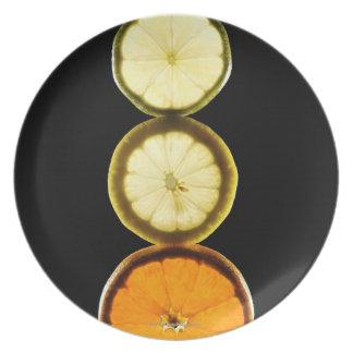 Lime,Grapefruit,Lemon,Fruit,Black background Plate