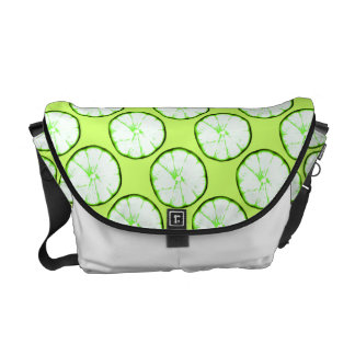 lime slices on vibrant green background commuter bag