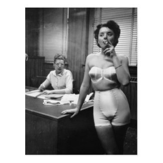 Lingerie model smoking in an office postcard