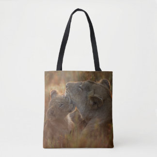 Lion cub aged about 12 months playing tote bag