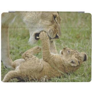 Lion cub playing with female lion, Masai Mara iPad Cover