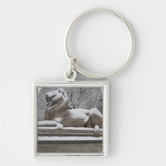 Lion sculpture covered in snow key ring