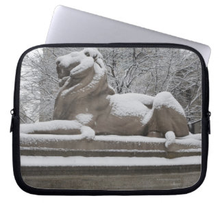 Lion sculpture covered in snow laptop sleeve