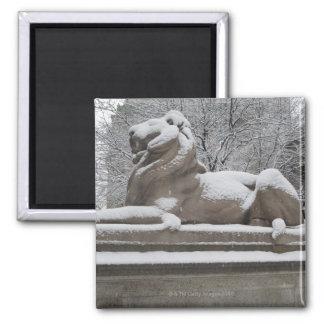 Lion sculpture covered in snow fridge magnet