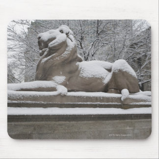 Lion sculpture covered in snow mouse mat