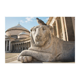 Lion statue in front of historic church canvas print